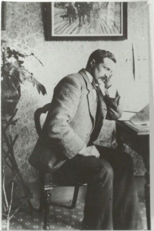 Jesse Taylor, seated indoors.