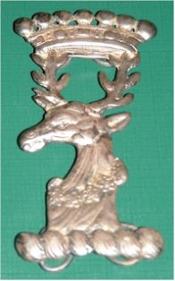Silver Almshouse badge of a stag with a wreath of flowers round its neck, and a Baronet's coronet on its antlers