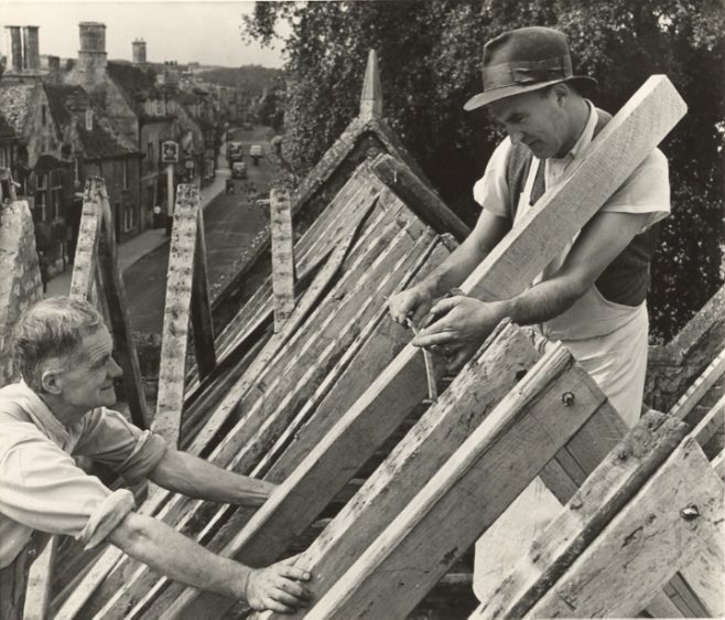 Two men Re-roofing the Market Hall
