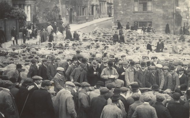 Sheep market in Campden Square - all men, all wearing hats!