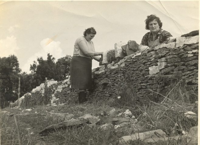 two women dry stone walling in the 1940s