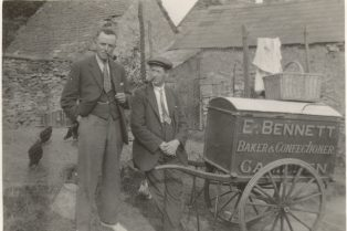 Enoch Bennett, another man and two wheeled breadcart
