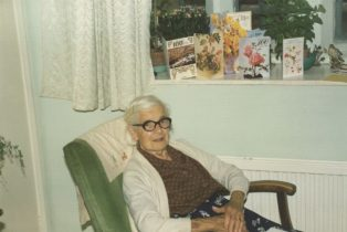 Bertha Cooper, 100 years old, in her almshouse