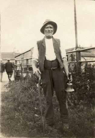 Man holding bell near market