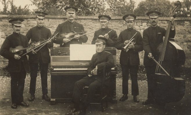 Seven bandsmen in uniform
