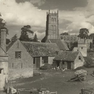 The barn and 'henyard' with the church in the background