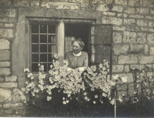 District Nurse at window