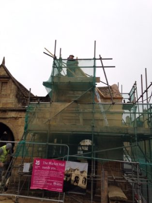Building with scaffolding and masons   CCHS