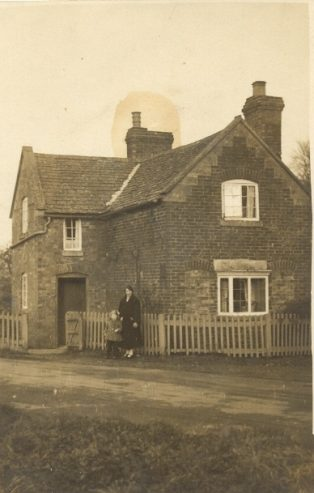 Mrs Bickley outside corner house at Paul's Pike