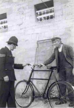 Campden Policeman returning stolen bicycle to Alec Cooper