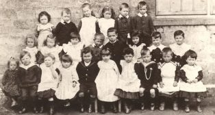 Infant School 1906. Some of the little boys are still in skirts and smocks