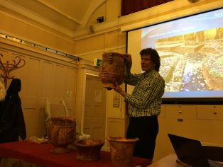 Stephen Wass displaying some of the pots found at Hanwell
