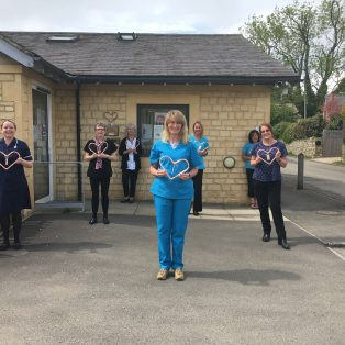 The GPs at Campden surgery presented the staff with hearts in thanks for their efforts. The hearts are made locally of copper.