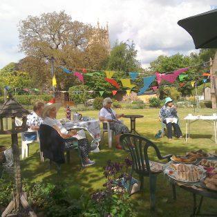 Almshouses residents enjoying a celebratory tea