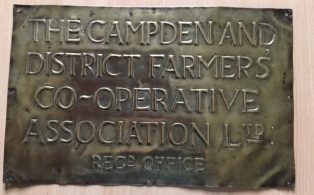 Brass sign for Farmers Co-op