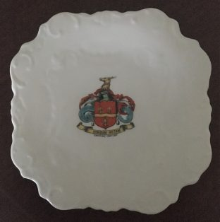 White plate with Noel coat of arms.