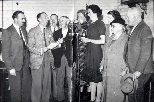(from left) Barney Colehan, Wilfred Pickles, Bill Payne, George Hawkins, Joyce Baker, Eileen Keyte, Mrs Daumby, Mrs Drinkwater and James 'Teapot' Williams