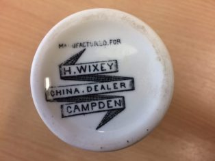The bases of the china items show that they were purchased specifically for H. Wixey