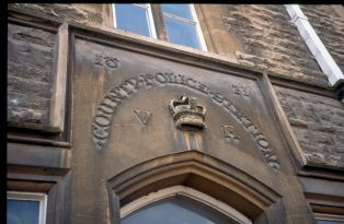 The carving over the front door of the Police Station