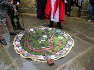 he embroidered cover depicting the Cotswold Way, removed at unveiling of marker
