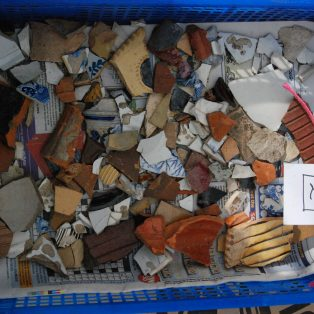 tray of pottery sherds from the dig | Mary Fielding