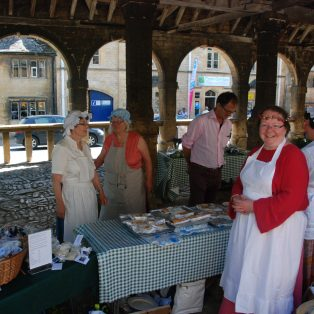 Customers and vendors dressed in costume at Campden Country Market in the Market Hall | Mary Fielding