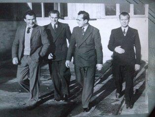 Four men walking