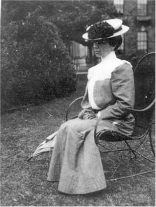 Miss Josephine Griffiths in mid life seated in a garden