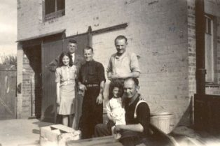 Lionel Ellis and Joan Horne, neighbour, with the three POWs and Judith