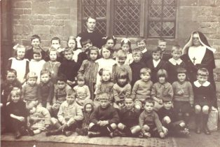 Schoolchildren with Father Bilsberrow and unnamed nun