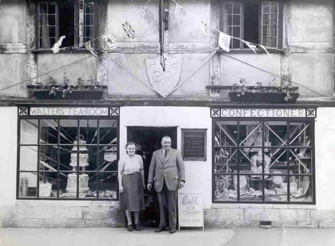 Still called Walters, but run by Mr & Mrs Frank James. This photo was taken in 1953 when Frank, a noted confectioner, made cakes as the Royal Regalia.
