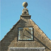 Sundial on outbuilding at Cotswold House Hotel