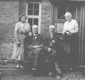 Jesse Taylor, seated left, with his brother Thomas and sister Mary. His daughter Dorothy is standing left | Jesse Taylor