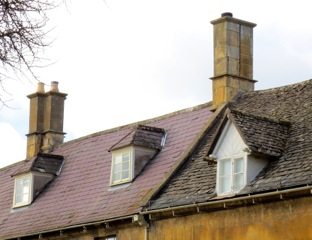 Welsh slate roof on the left, traditional Cotswold stone on the right