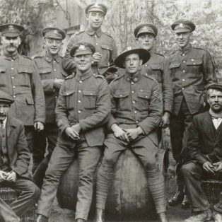Campden soldiers on leave - enjoying themselves at the Eight Bells. Standing left to right: Tom Harris, Ormond Plested, Lawrence Ladbrook, Tom Nobes, Frank Nobes. Seated centre: Harry Nobes, Jack Tomes