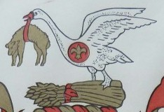 close up of swan with sheep in beak, standing on sheaf of wheat